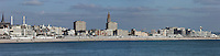 Panoramic view of the beach and city of Le Havre, Normandy, France. In the centre is the tower of the Eglise Saint-Joseph or St Joseph's Church, built 1951-58 as a memorial to the 5000 citizens of the town who died during the Second World War, designed by Auguste Perret, 1874-1954, and Raymond Audigier. Either side are the apartment blocks at Porte Oceane, completed 1956, also designed by Perret, who led the reconstruction of Le Havre in the 1950s, after the town was completely destroyed in WWII. The centre of Le Havre is listed as a UNESCO World Heritage Site. Picture by Manuel Cohen
