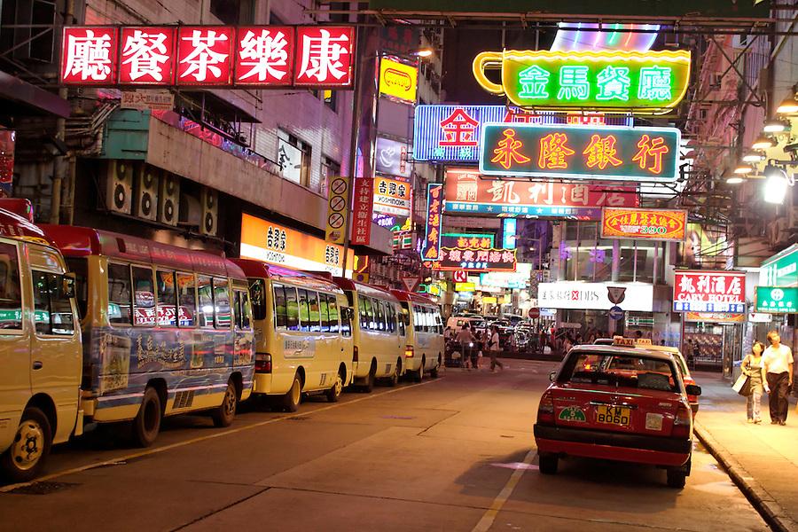 Signs above street in downtown Kowloon, Hong Kong SAR, China, Asia