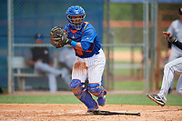 GCL Mets catcher Jose Mena (38) prepares to throw to first base as Christopher Rodriguez (7) slides home during a game against the GCL Marlins on August 3, 2018 at St. Lucie Sports Complex in Port St. Lucie, Florida.  GCL Mets defeated GCL Marlins 3-2.  (Mike Janes/Four Seam Images)
