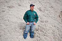 Leighton Stovall (cq), manager of the Moore County Cotton Gin, stands in a pile of cotton seed in Dumas, Texas, Monday, February 14, 2011. With the high price of cotton in recent years, many farmers in the area have switched to start farming cotton...Photo by Matt Nager