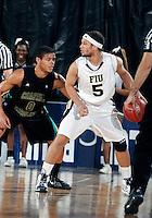 Florida International University guard Steven Miro (5) plays against Coastal Carolina University.  FIU won the game 64-62 on November 26, 2011 at Miami, Florida. .