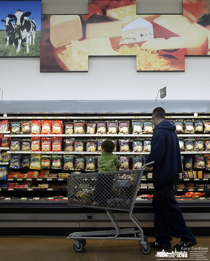Mike Terrill and his son Joseph shop for cheese at Wal-Mart Thursday, March 2, 2006, in Grove City, Ohio.<br />