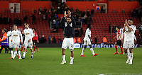 Pictured: Kyle Naughton (C) and Neil Taylor (R) of Swansea thanks away supporters Sunday 01 February 2015<br />