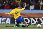 20 JUN 2010:  Emmanuel Eboue (CIV)(on ground) slide tackles the ball off the foot of Kaka (BRA)(10).  The Brazil National Team led the C'ote d'Ivoire National Team 1-0 at the end of the first half at Soccer City Stadium in Johannesburg, South Africa in a 2010 FIFA World Cup Group G match.