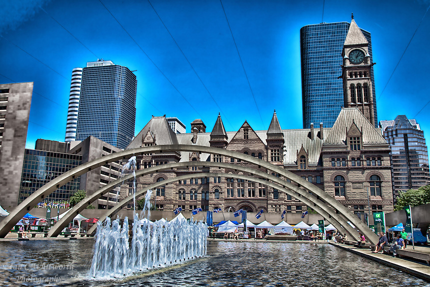 A photo art view of Old City Hall in Toronto with Nathan Phillips Square fountains in the foreground.
