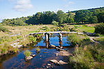 Historic medieval Clapper Bridge at Postbridge, Dartmoor national park, Devon, England crossing the East Dart river
