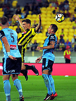 Matthew Ridenton is nudged in midair during the A-League football match between Wellington Phoenix and Sydney FC at Westpac Stadium in Wellington, New Zealand on Saturday, 23 December 2017. Photo: Dave Lintott / lintottphoto.co.nz