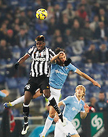 Paul Pogba  and  Marco Parolo    in action during the Italian Serie A soccer match between   SS Lazio and FC Juventus   at Olimpico  stadium in Rome , November 22, 2014