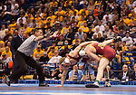 =March 21 2009      Craig Brester (red, at left) from Nebraska battles Jake Varner (maroon) from Iowa State in the 197 pound weight class in the championship round of the NCAA Division I  Wrestling Championships which were held March 19 through March 21, 2009 at the Scottrade Center in downtown St. Louis, Missouri.  ..         *******EDITORIAL USE ONLY*******