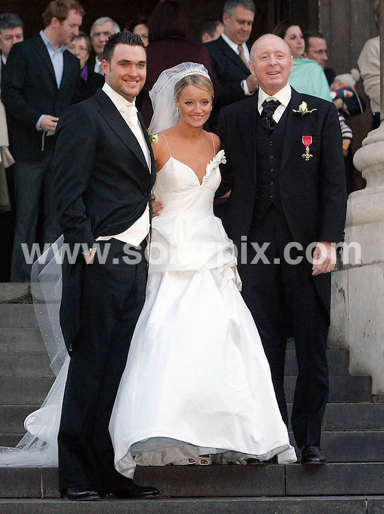 **ALL ROUND PICTURES FROM SOLARPIX.COM**                                             **NO UK NEWSPAPER PUBLICATION**.**UK MAGAZINE & SUPPLEMENT PUBLICATION ONLY** AND NO PUBLICATION IN AUSTRALIA, BELGIUM, FRANCE, GERMANY, ITALY, SCANDINAVIA AND USA**                                                                                  The Office star Lucy Davis has divorced her husband of five years, The Mentalist heartthrob Owain Yeoman..The couple separated in January, and filed divorce papers in L.A. County Superior Court earlier this month, citing irreconcilable differences..Lucy and Owain married in 2006 following a whirlwind six month romance, and have no children..Pic shows:  Bride and Groom  Lucy Davis and Owain Yeoman with Lucys father Jasper Carrot outside  St Paul's Cathedral in Central London on the 9th December 2009 after their wedding.                                                                                           JOB REF:    14122    SFE       DATE:  29.10.11                                                          **MUST CREDIT SOLARPIX.COM OR DOUBLE FEE WILL BE CHARGED**                                                                      **MUST AGREE FEE BEFORE ONLINE USAGE**                               **CALL US ON: +34 952 811 768 or LOW RATE FROM UK 0844 617 7637**