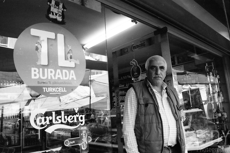 Business owners proudly posing in front of their shops. Zeytinburnu area, Istanbul.