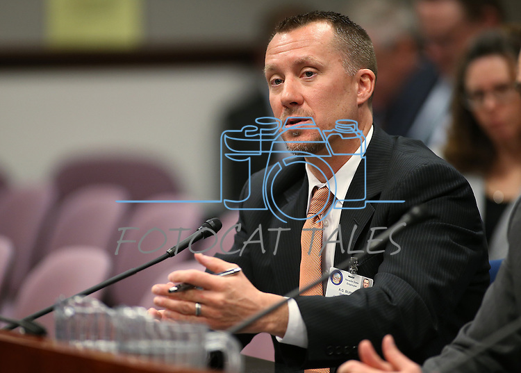 Nevada Gaming Control Board Chairman A.G. Burnett testifies in a committee hearing at the Legislative Building in Carson City, Nev., on Monday, April 27, 2015. <br /> Photo by Cathleen Allison