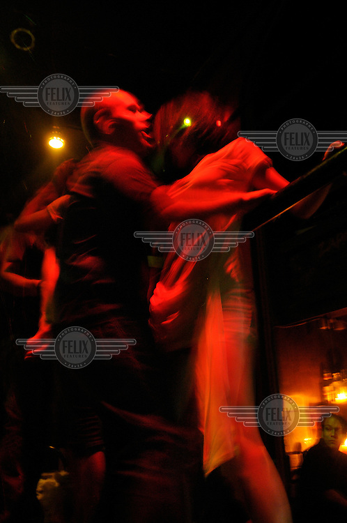 Western man dancing with a Chinese girl at a nightclub in the former French Concession.