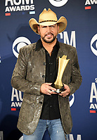 LAS VEGAS, NEVADA - APRIL 07: Artist of the Decade award winner Jason Aldean poses in the press room during the 54th Academy Of Country Music Awards at MGM Grand Hotel &amp; Casino on April 07, 2019 in Las Vegas, Nevada. <br /> CAP/MPIIS<br /> &copy;MPIIS/Capital Pictures