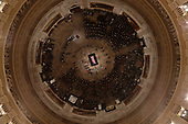People begin to fill out as Former President George H. W. Bush lies in state in the U.S. Capitol Rotunda Monday, Dec. 3, 2018, in Washington. (Pool photo by Morry Gash via AP)