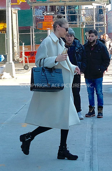 www.acepixs.com<br /> <br /> January 10 2018, New York City<br /> <br /> Model Gigi Hadid bundles up in a white coat as she leaves her East Village apartment on January 10 2018 in New York City<br /> <br /> By Line: Curtis Means/ACE Pictures<br /> <br /> <br /> ACE Pictures Inc<br /> Tel: 6467670430<br /> Email: info@acepixs.com<br /> www.acepixs.com
