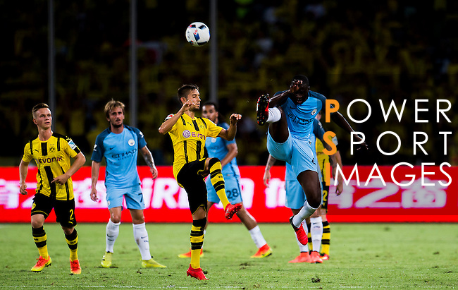 SHENZHEN - JULY 28: Manchester City midfielder Yaya Toure (r) in action during the match between Borussia Dortmund vs Manchester City FC at the 2016 International Champions Cup China match at the Shenzhen Stadium on 28 July 2016 in Shenzhen, China. (Photo by Power Sport Images/Getty Images)