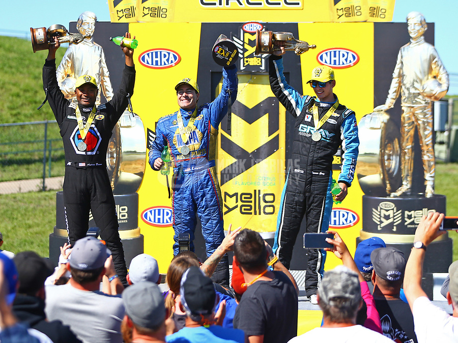 May 21, 2017; Topeka, KS, USA; (From left) NHRA top fuel driver , funny car driver Ron Capps and pro stock driver Tanner Gray celebrate after winning the Heartland Nationals at Heartland Park Topeka. Mandatory Credit: Mark J. Rebilas-USA TODAY Sports