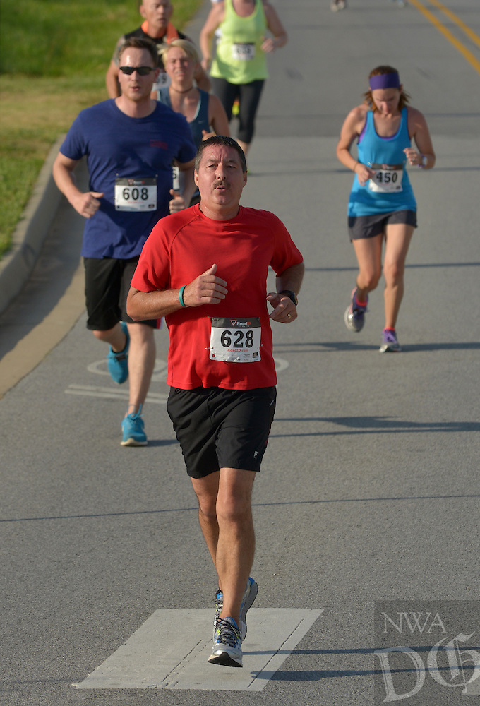 NWA Democrat-Gazette/BEN GOFF -- 06/13/15 Larry Wallace of Pea Ridge runs in the 5K on Saturday June 13, 2015 during The Cancer Challenge 10K, 5K Run & 1-Mile Walk at Memorial Park in Bentonville.