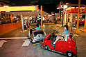 "KIDZANIA TOKYO, ""Edutainment City"",.children driving into the gas station."