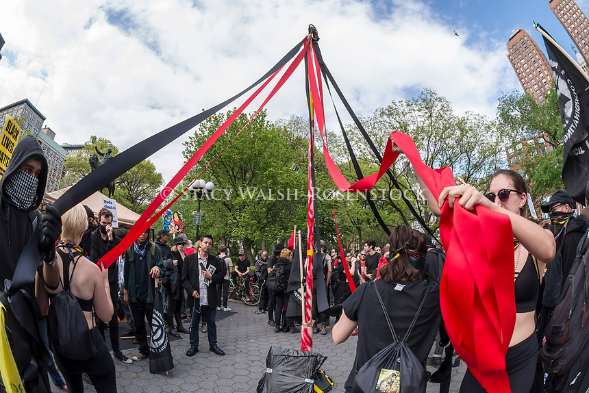 New York, NY 1 May 2017 - Anarchists dance around a Maypole  at a May Day rally ifor Inernational Workers Day in Union Square Park. ©Stacy Walsh Rosenstock/Alamy Live News