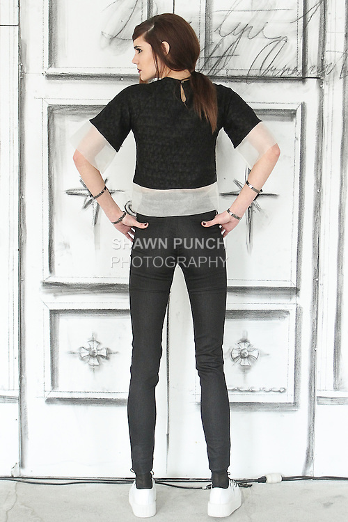 Model wears outfit from the Astier NY Fall Winter 2015 collection by Jackie Astier, at 11 East 68 Street penthouse on March 10, 2015.