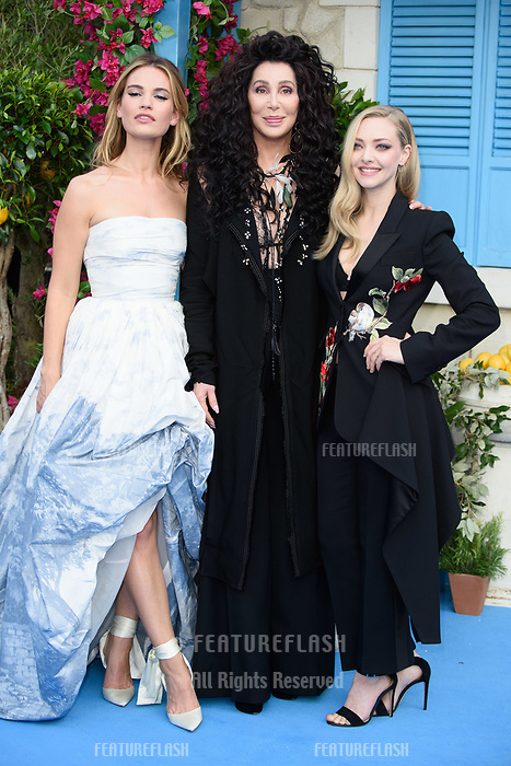 """Lily James, Cher & Amanda Seyfried arriving for the """"Mama Mia! Here We Go Again"""" world premiere at the Eventim Apollo, Hammersmith, London, UK. <br /> 16 July  2018<br /> Picture: Steve Vas/Featureflash/SilverHub 0208 004 5359 sales@silverhubmedia.com"""