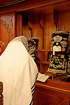 Israel, Bnei Brak. The Synagogue of the Premishlan congregation on Purim holiday. The Rabbi in front of the Torah, 2005<br />