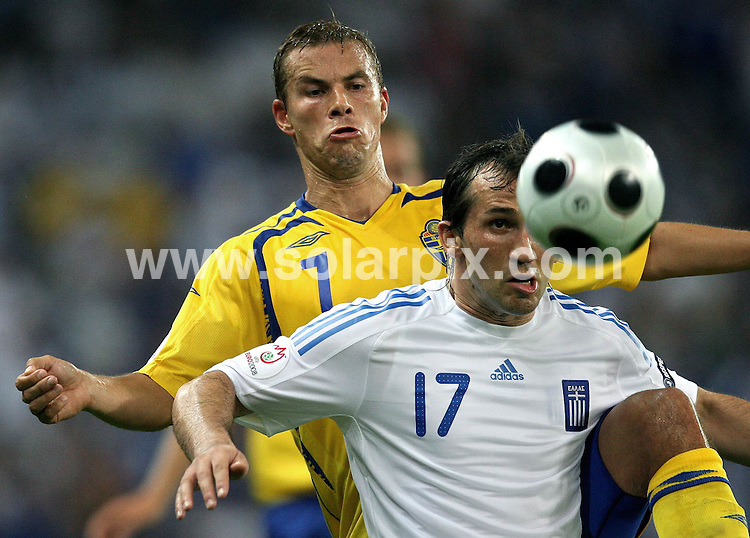 **ALL ROUND PICTURES FROM SOLARPIX.COM**.**SYNDICATION RIGHTS FOR UK AND SPAIN ONLY**.European Championship tournament Euro 2008, Greece versus Sweden at the Wals-Siezenheim Stadium, Salzburg, Austria. Sweden 2 Greece 0. 10th June 2008..This pic: Theofanis Gekas and Niclas Alexandersson..JOB REF: 6606 CPR/Ronny Hartmann       .DATE: 10_06_2008.**MUST CREDIT SOLARPIX.COM OR DOUBLE FEE WILL BE CHARGED* *UNDER NO CIRCUMSTANCES IS THIS IMAGE TO BE REPRODUCED FOR ANY ONLINE EDITION WITHOUT PRIOR PERMISSION*