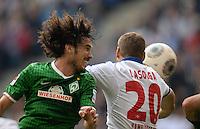 FUSSBALL   1. BUNDESLIGA   SAISON 2013/2014   6. SPIELTAG Hamburger SV - SV Werder Bremen                       21.09.2013 Santiago Garcia (li, SV Werder Bremen) gegen Pierre-Michel Lasogga (re, Hamburger SV)
