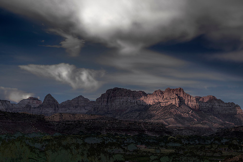 The sun sets at Zion National Park after a thunderstorm passes the area in Utah
