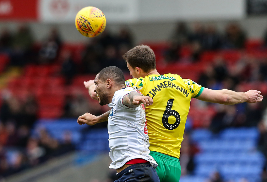 Bolton Wanderers' Josh Magennis competing with Norwich City's Christoph Zimmermann  <br /> <br /> Photographer Andrew Kearns/CameraSport<br /> <br /> The EFL Sky Bet Championship - Bolton Wanderers v Norwich City - Saturday 16th February 2019 - University of Bolton Stadium - Bolton<br /> <br /> World Copyright © 2019 CameraSport. All rights reserved. 43 Linden Ave. Countesthorpe. Leicester. England. LE8 5PG - Tel: +44 (0) 116 277 4147 - admin@camerasport.com - www.camerasport.com