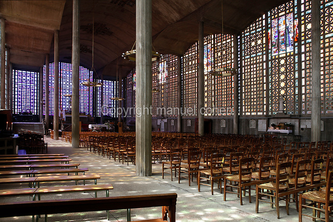 Low angle view of the nave of the church of Notre-Dame du Raincy on May 24, 2009 in Le Raincy, Seine Saint Denis, France. Built in 1922-1923 by the architects and brothers Auguste and Gustave Perret, the cathedral was the first one to be built with reinforced concrete. The stained glass was created by Marguerite Hure based on sketches by Maurice Denis. Picture by Manuel Cohen
