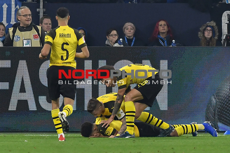 08.12.2018, Veltins-Arena, Gelsenkirchen, GER, 1. FBL, FC Schalke 04 vs. Borussia Dortmund, DFL regulations prohibit any use of photographs as image sequences and/or quasi-video<br /> <br /> im Bild Jadon Sancho (#7, Borussia Dortmund) jubelt nach seinem Tor zum 1:2 mit Marco Reus (#11, Borussia Dortmund) Axel Witsel (#28, Borussia Dortmund) <br /> <br /> Foto &copy; nordphoto/Mauelshagen