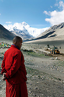 A monk overlooks the roadworks in front of Rongbuk Monastery at Everest base camp.<br /> China started building a controversial 67-mile &quot;paved highway fenced with undulating guardrails&quot; to Mount Qomolangma, known in the west as Mount Everest, to help facilitate next year's Olympic Games torch relay.