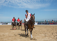 Tarquin Southwell of England heads off after defeat to Wales during the Wales v England match at the Asahi Beach Polo Championship  at Sandbanks, Poole, England on 10 July 2015. Photo by Andy Rowland.