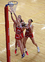 28.10.2014 Silver Ferns Leana de Bruin and England's Jo Harten in action during the Silver Ferns V England netball match played at the Rotorua Events Centre in Rotorua. Mandatory Photo Credit ©Michael Bradley.