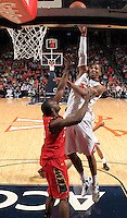 Virginia forward Akil Mitchell (25) shoots over Maryland forward James Padgett (35) during the game Sunday in Charlottesville, VA. Virginia defeated Maryland in overtime 61-58. Photo/Andrew Shurtleff