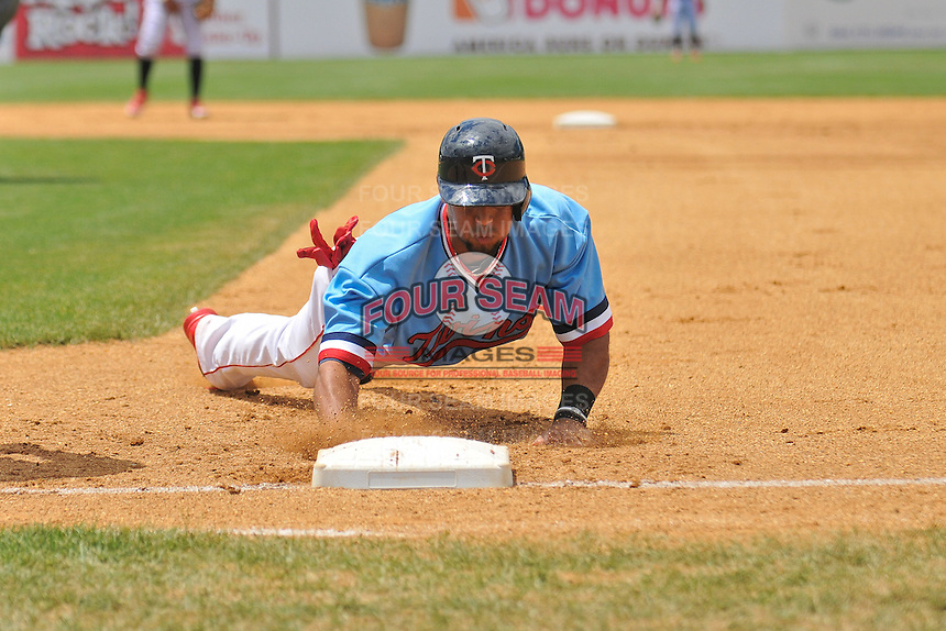 Aaron Hicks (32) of the New Britain Rock Cats dives back to first base during a game against the Reading Fightin Phils at New Britain Stadium on June 22, 2014 in New Britain, Connecticut.  New Britain defeated Reading 5-3.  (Gregory Vasil/Four Seam Images)