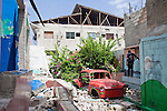 A man stands in the rubble of a former school on July 7, 2010 in Port-au-Prince, Haiti.
