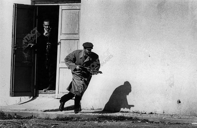 Turkish militia leaving the side entrance of a cinema, Limassol, Cyprus, 1964.