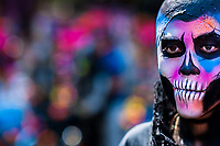 A Mexican man, having his face colorfully painted with skull, takes part in the Day of the Dead festival in Mexico City, Mexico, 29 October 2016. Day of the Dead (Día de Muertos), a syncretic religious holiday combining the death veneration rituals of the ancient Aztec culture with the Catholic practice, is celebrated throughout all Mexico. Based on the belief that the souls of the departed may come back to this world on that day, people gather at the gravesites in cemeteries praying, drinking and playing music, to joyfully remember friends or family members who have died and to support their souls on the spiritual journey.