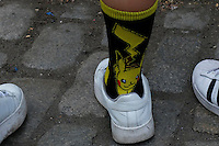 """NEW YORK, NY - JULY 24 : A woman wears socks of Pikachu while people play the augmented reality mobile game """"Pokemon Go"""" by Nintendo on July 24, 2016 in Manhattan, New York. Photo by VIEWpress"""