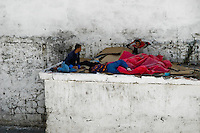 Young Moroccan immigrants sleep outside the port of Tanger after unsuccessful night attempt to cross the port's checkings, Morocco, 17 June 2007. Every day tens of Moroccan young men try to cross ilegally the Strait of Gibraltar. ?Harraga? (immigrants in Arabic) come to Tanger from all over Morocco. They try their good luck and hidden between the wheels of a truck they attempt to board on a ferry and get to Spain, eventually further to Europe. Considering the thorough checks at the port only few of them make it. Therefore they spend months living on a beach, in huts along the walls of the port, begging for food and waiting for the right night so as their dream about Europe came true.