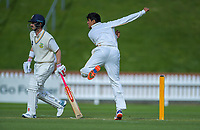 Wellington's Rachin Ravindra bowls past Otago's Hamish Rutherford during day two of the Plunket Shield cricket match between the Wellington Firebirds and Otago Volts at the Basin Reserve in Wellington, New Zealand on Tuesday, 22 October 2019. Photo: Dave Lintott / lintottphoto.co.nz