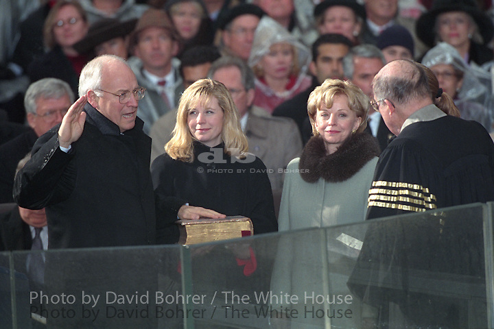 GEORGE W. BUSH IS SWORN- IN AS THE 43RD PRESIDENT IN AN INAUGURAL CEREMONY AT THE UNITED STATES CAPITOL (RELEASE P182-4). THE OATH IS ADMINISTERED BY CHIEF JUSTICE WILLIAM REHNQUIST. LAURA BUSH HOLDS THE BIBLE DURING THE OATH. THE BUSHES' DAUGHTERS JENNA AND BARBARA STAND WITH THEM.  RICHARD (DICK) CHENEY IS SWORN IN AS VICE PRESIDENT. HIS WIFE LYNNE, AND DAUGHTERS, MARY AND ELIZABETH STAND WITH HIM AS CHIEF JUSTICE REHNQUIST ADMINISTERS THE OATH.  PRESIDENT BUSH DELIVERS HIS INAUGURAL SPEECH. CEREMONY GUESTS INCLUDE: PRESIDENT BILL CLINTON, HILLARY RODHAM  CLINTON, PRESIDENT GEORGE H.W. BUSH, BARBARA BUSH, PRESIDENT JIMMY CARTER, ROSALYNN CARTER, VICE PRESIDENT AL GORE, TIPPER GORE, DORO BUSH KOCH, BOBBY KOCH, CHELSEA CLINTON, SEN. TRENT LOTT, SEN. MITCH MCCONNELL AND OTHERS.  PRESIDENT-ELECT BUSH TALKS WITH VP GORE AND VICE PRESIDENT-ELECT CHENEY IN A HOLDING ROOM PRIOR TO THE CEREMONY. . PARTICIPANTS, GUESTS AND FAMILY MEMBERS WALK THROUGH THE CAPITOL EN ROUTE THE CEREMONY, INCLUDING: CHIEF JUSTICE REHNQUIST, JUSTICES JOHN PAUL STEVENS,  ANTONIN SCALIA, ANTHONY KENNEDY, DAVID SOUTER, CLARENCE THOMAS, RUTH BADER GINSBUG, STEPHEN BREYER; FORMER HOUSE SPEAKER  AND MRS. NEWT GINGRICH, PRESIDENT AND MRS. JIMMY CARTER, PRESIDENT AND MRS. GEORGE H.W. BUSH, FORMER VICE PRESIDENT AND MRS. DAN QUAYLE (MARILYN), FORMER SEC. JAMES A. BAKER, FORMER SEC. NICHOLAS BRADY, FORMER SEN. ALAN SIMPSON, BOBBY AND GIGI KOCH AND OTHERS. SEN. KAY BAILEY HUTCHISON GREETS THE JUSTICES. PRESIDENT BUSH KISSES HIS DAUGHTERS IN A CAPITOL HALLWAY FOLLOWING THE CEREMONY. LAURA BUSH LOOKS ON AS THE GIRLS TALK WITH THEIR FATHER (JUMBO P20-20A).  THE BUSHES WALK THROUGH THE ROTUNDA. THEY ESCORT THE CLINTONS DOWN THE STEPS THEIR LIMOUSINE. THE CLINTONS DEPART FOR ANDREWS AIR FORCE BASE. THE CHENEYS WALK DOWN THE STEPS WITH THE GORES. Location: U.S. CAPITOL                                                                     Additional keywords: RELEASE BOOK  Used in 40th Anniversary Slide Show. VP Ch