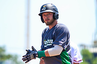 Clinton LumberKings first baseman Ryan Costello (13) claps his hands after hitting a triple during a Midwest League game against the Cedar Rapids Kernels on May 28, 2018 at Perfect Game Field at Veterans Memorial Stadium in Cedar Rapids, Iowa. Clinton defeated Cedar Rapids 4-3. (Brad Krause/Four Seam Images)