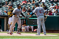 Miguel Olivo (38) of the Sacramento River Cats  congratulated by teammate Jarrett Parker (47) after hitting a home run against the Salt Lake Bees in Pacific Coast League play at Smith's Ballpark on May 01,  2016 in Salt Lake City, Utah. Sacramento defeated Salt Lake 16-6.  (Stephen Smith/Four Seam Images)