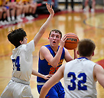 Roxana forward Jake Golenor (center) is guarded by Alton Marquette guard Owen Williams (left) as Alton Marquette forward Jaxson Hendricks moves in. Alton Marquette played Roxana in the Class 2A Roxana boys basketball regional final at Roxana High School in Roxana, Illinois on Friday February 28, 2020. <br /> Tim Vizer/Special to STLhighschoolsports.com