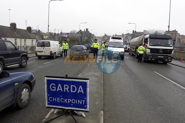 Garda checkpoint on the Bridge of Peace.Pic  Fran Caffrey Newsfile..Camera:   DCS620C.Serial #: K620C-01974.Width:    1728.Height:   1152.Date:  24/3/01.Time:   3:27:05.DCS6XX Image.FW Ver:   3.2.3.TIFF Image.Look:   Product.Sharpening Requested: No.Counter:    [16292].Shutter:  1/200.Aperture:  f10.ISO Speed:  400.Max Aperture:  f2.8.Min Aperture:  f22.Focal Length:  17.Exposure Mode:  Manual (M).Meter Mode:  Color Matrix.Drive Mode:  Continuous High (CH).Focus Mode:  Single (AF-S).Focus Point:  Center.Flash Mode:  Normal Sync.Compensation:  +0.0.Flash Compensation:  +0.0.Self Timer Time:  5s.White balance: Auto.Time: 03:27:05.800.